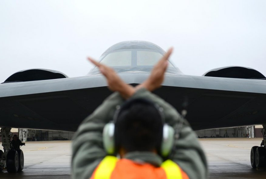 A crew chief from Whiteman Air Force Base, Mo., marshals in a B-2 Spirit stealth bomber at Whiteman Air Force Base, Mo., Jan 19, 2017 (U.S. Air Force photo by Senior Airman Joel Pfiester)