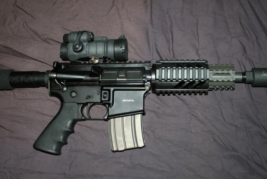 OA K23 Pistol with Aimpoint and Noveske Firing Breathing Pig. Flickr/Stephen Z.