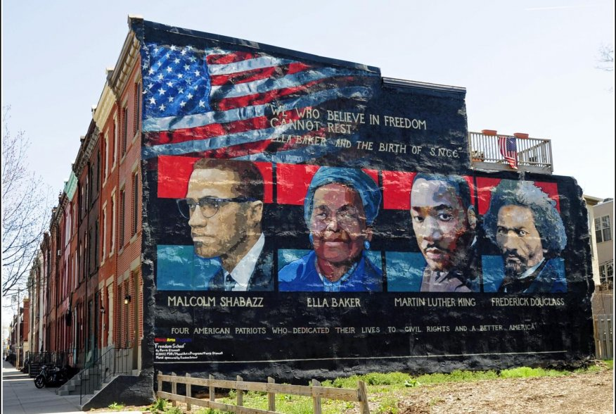 Mural on the wall of row houses in Philadelphia. The artist is Parris Stancell, sponsored by the Freedom School Mural Arts Program. 17 April 2009. Flickr/Tony Fischer. Creative Commons Attribution 2.0 Generic (CC BY 2.0)