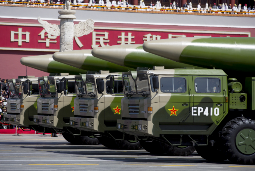 Military vehicles carrying DF-26 ballistic missiles travel past Tiananmen Gate during a military parade to commemorate the 70th anniversary of the end of World War II in Beijing Thursday Sept. 3, 2015. REUTERS/Andy Wong/Pool