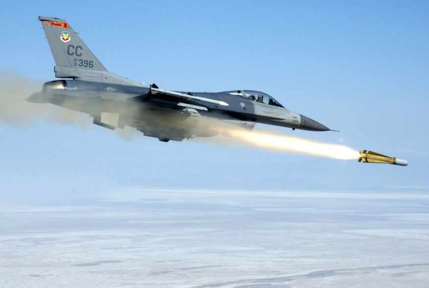 "First Lieutenant David ""Trigger"" Zeytoonjian, an F-16C Fighting Falcon assigned to the 522nd Fighter Squadron ""Fireballs"", Cannon Air Force Base, New Mexico, fires an AGM-65H Maverick air-to-ground missile at a target located on the Utah Test and Training"
