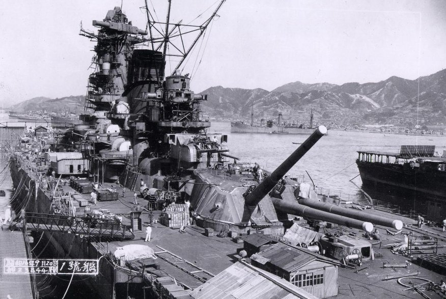 The Japanese battleship Yamato in the late stages of construction alongside of a large fitting out pontoon at the Kure Naval Base, Japan, 20 September 1941. U.S. Navy, courtesy of Lieutenant Commander Shizuo Fukui.