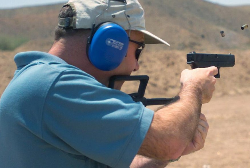 US Marine Corps Colonel James Cooney, Commander, Marine Corps Air Station Yuma, Arizona, fires a 9mm Glock 18 machine pistol while attending a period foreign military small arms weapons course at Adair MCAS) Yuma, Arizona. U.S. Marine Corps.