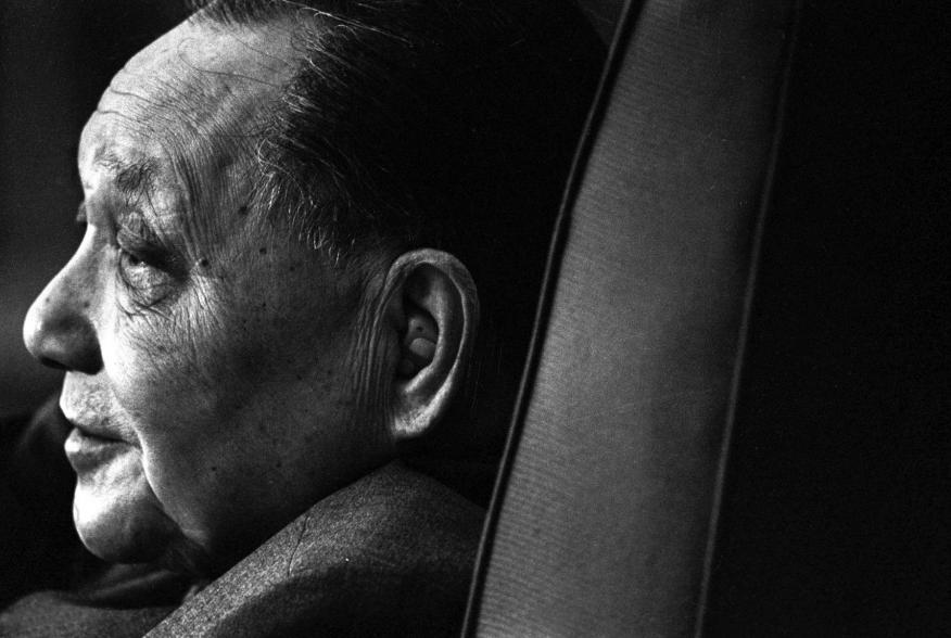 Deng Xiaoping, the initiator of China's reform and opening-up policy, is seen at the Great Hall of the People during a meeting in Beijing in this 1985 file photo. As China battles an economic slowdown that could test Communist Party control, its leaders a