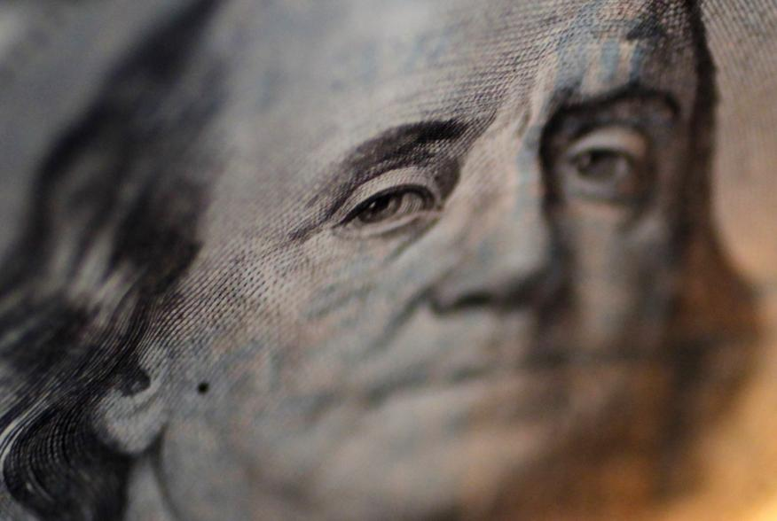 A portrait of Benjamin Franklin on a U.S. One-hundred dollar bill is pictured at Interbank Inc. money exchange in Tokyo, in this September 9, 2010 picture illustration. The dollar neared a 15-year low versus the yen on Thursday as traders bet Japanese aut