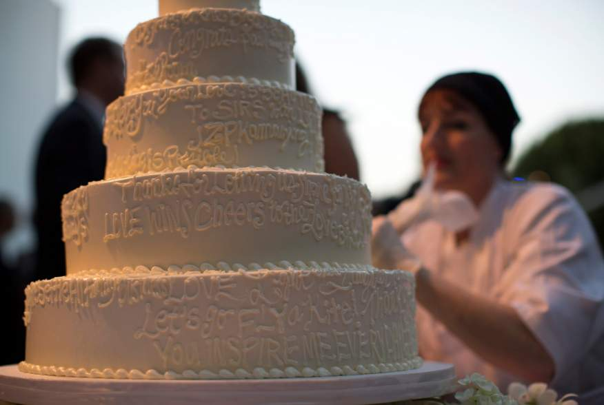A wedding cake is decorated with messages from guests at a ceremony to celebrate the wedding of Paul Katami and Jeff Zarrillo at Beverly Hilton Hotel in Beverly Hills, California June 28, 2014.