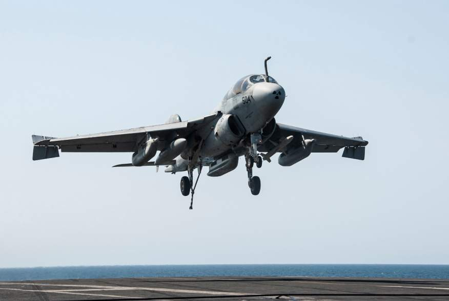 An EA-6B Prowler attached to the Garudas of Electronic Attack Squadron (VAQ) 134 lands aboard the aircraft carrier USS George H.W. Bush (CVN 77) after conducting strike missions against the Islamic State of Iraq and the Levant (ISIL)