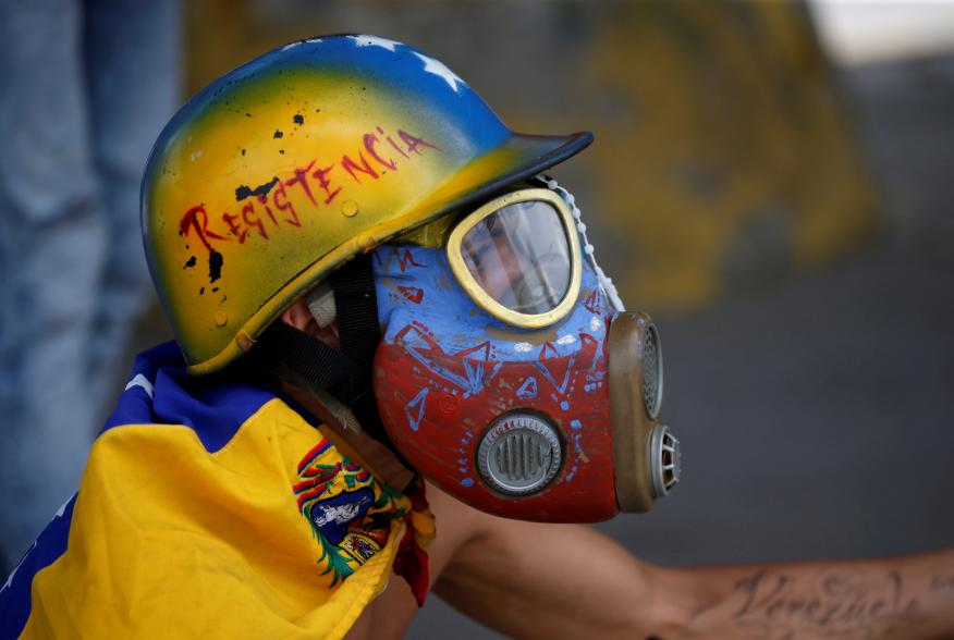 A demonstrator looks on while clashing with riot security forces during a rally against Venezuela's President Nicolas Maduro's government in Caracas, Venezuela, August 12, 2017. REUTERS/Andres Martinez Casares