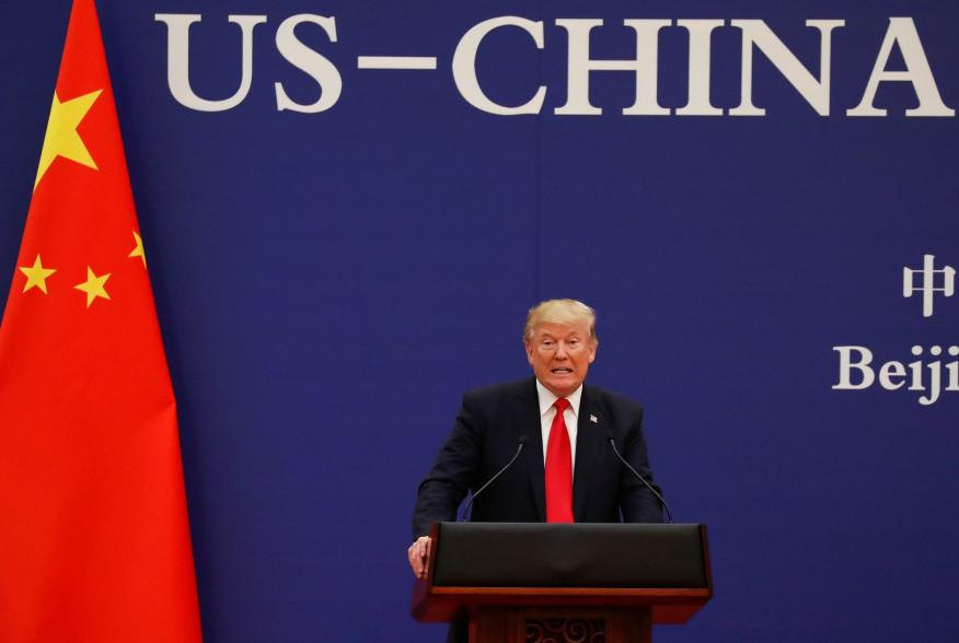 U.S. President Donald Trump delivers his speech as he and China's President Xi Jinping meet business leaders at the Great Hall of the People in Beijing, China, November 9, 2017. REUTERS/Damir Sagolj
