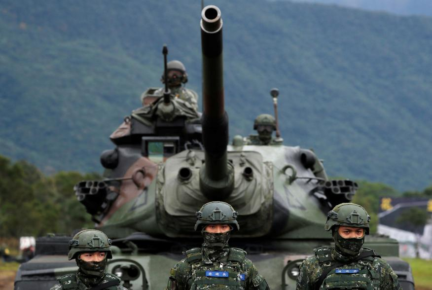 Taiwanese soldiers stand in front of a M60A3 tank during a military drill in Hualien, eastern Taiwan, January 30, 2018. REUTERS/Tyrone Siu