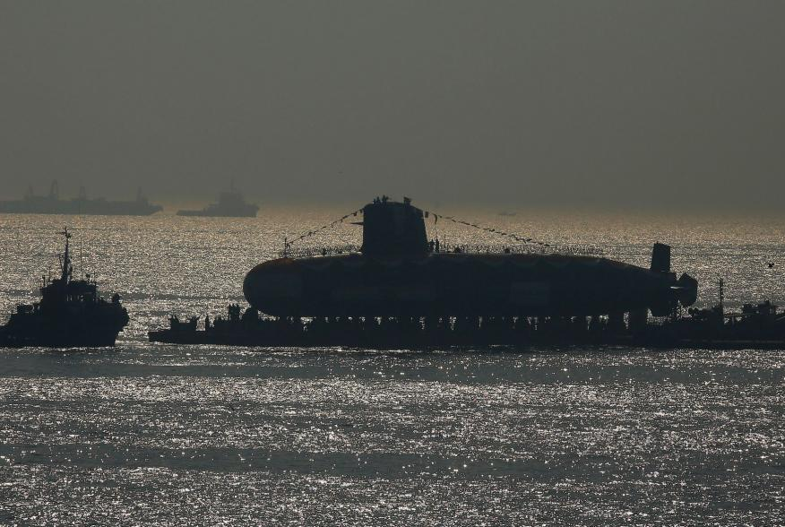 India's third Scorpene-class submarine INS Karanj is seen silhouetted as a tugboat pulls it during its launch at the Mazagon Dock Ltd. naval shipbuilding yard, in Mumbai, India January 31, 2018. REUTERS/Shailesh Andrade TPX IMAGES OF THE DAY