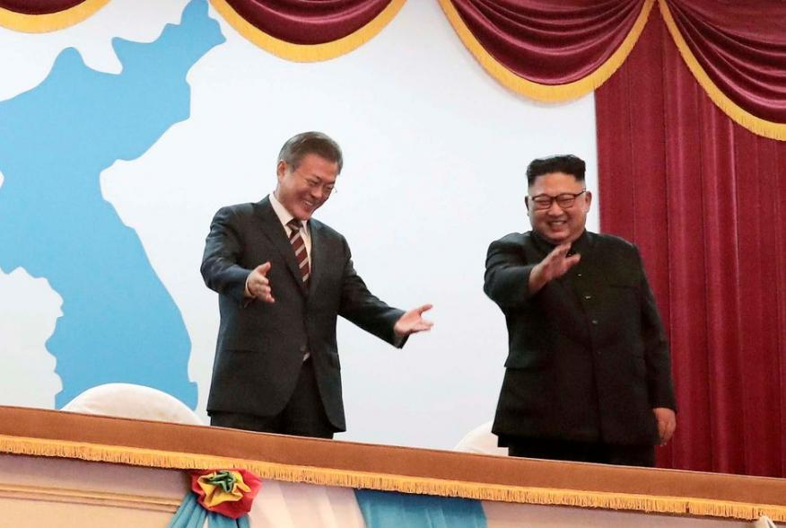 South Korean President Moon Jae-in talks with North Korean leader Kim Jong Un as they watch an art performance at Pyongyang Grand Theatre in Pyongyang, North Korea, September 18, 2018. Pyeongyang Press Corps/Pool via REUTERS