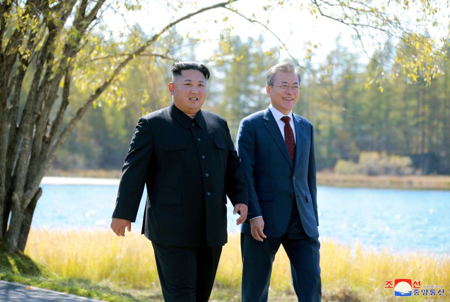 South Korean President Moon Jae-in and North Korean leader Kim Jong Un walk during a luncheon, in this photo released by North Korea's Korean Central News Agency (KCNA) on September 21, 2018. KCNA via REUTERS ATTENTION EDITORS - THIS IMAGE WAS PROVIDED BY