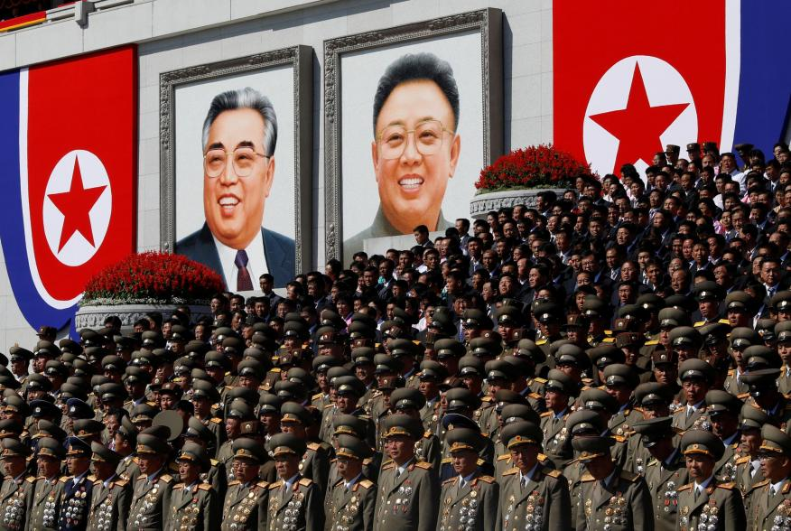 "Senior military officials watch a parade as portraits of late North Korean leaders Kim Il Sung and Kim Jong Il are seen in the background at the main Kim Il Sung square in Pyongyang, North Korea, September 9, 2018. REUTERS/Danish Siddiqui SEARCH ""DYNASTY"