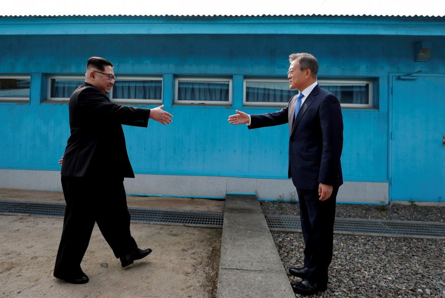 """South Korean President Moon Jae-in and North Korean leader Kim Jong Un shake hands at the truce village of Panmunjom inside the demilitarized zone separating the two Koreas, South Korea, April 27, 2018. Korea Summit Press Pool/Pool via Reuters SEARCH """"POY"""