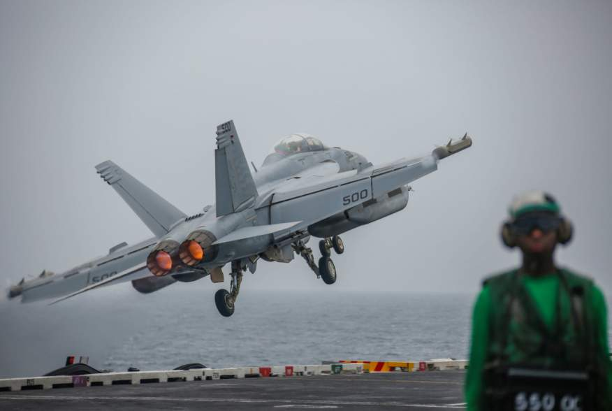 """An EA-18G Growler attached to the """"Patriots"""" of Electronic Attack Squadron (VAQ) 140 launches off the flight deck of the aircraft carrier USS Abraham Lincoln (CVN 72), in the Gulf, in this picture taken and released by U.S. Navy on August 29, 2019."""