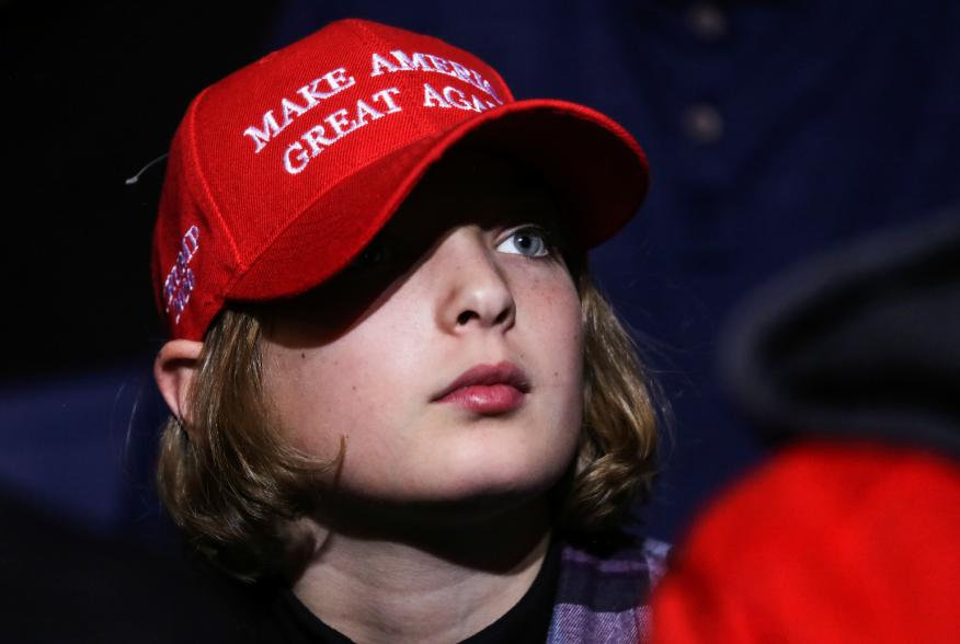 A supporter wearing a Make America Great Again (MAGA) hat attends U.S. President Donald Trump's campaign rally in Battle Creek, Michigan, U.S., December 18, 2019. REUTERS/Leah Millis?