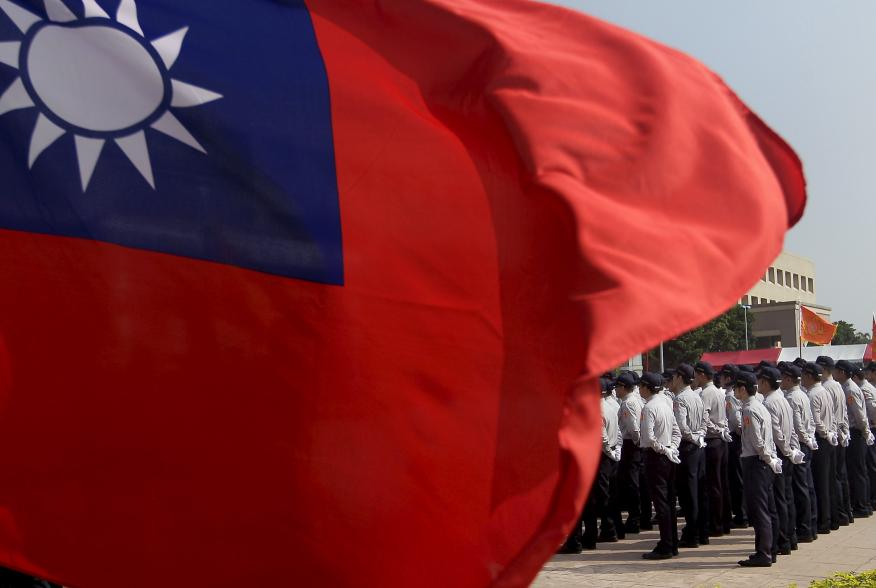 Members of the National Security Bureau take part in a drill next to a national flag at its headquarters in Taipei, Taiwan, November 13, 2015. REUTERS/Pichi Chuang