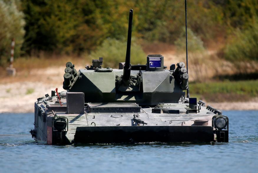 A ZBD-03 armoured infantry fighting vehicle, operated by a crew from China, drives through a water obstacle during the Paratrooper's platoon competition for airborne squads, part of the International Army Games 2016, at the Rayevsky shooting range outside