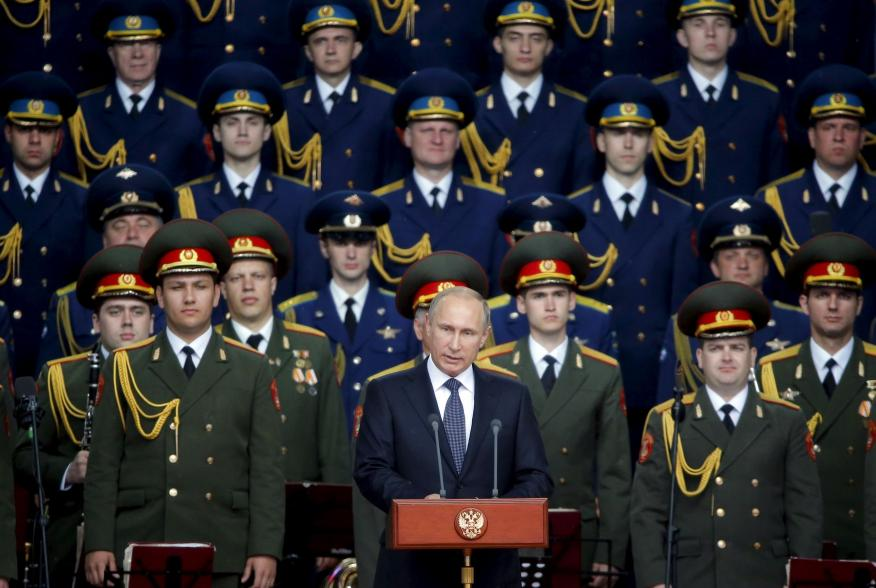 Russian President Vladimir Putin delivers a speech at the opening of the Army-2015 international military forum in Kubinka, outside Moscow, Russia, June 16, 2015. Putin said on Tuesday Russia would add more than 40 new intercontinental ballistic missiles