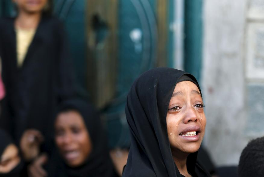 A girl cries after her father was killed by a Saudi-led air strike in Yemen's capital Sanaa July 13, 2015. Saudi-led air raids killed 21 civilians in Yemen's capital Sanaa on Monday morning, relatives of the victims and medics told Reuters, two days after