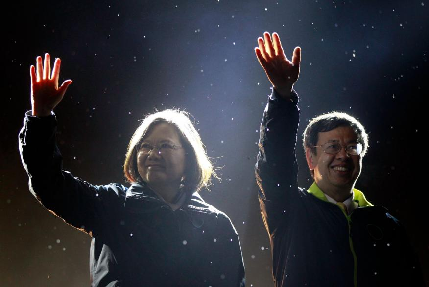 Taiwan's Democratic Progressive Party (DPP) Chairperson and presidential candidate Tsai Ing-wen (L) and vice presidential candidate Chen Chien-jen greet supporters as they take the stage during a final campaign rally ahead of the elections in Taipei, Taiw