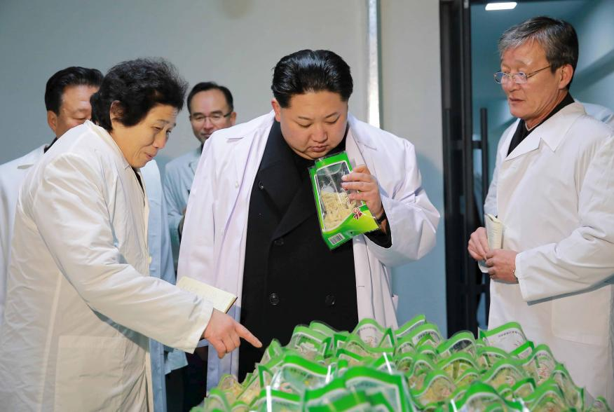 North Korean leader Kim Jong Un (C) visits the Kumkop General Foodstuff Factory for Sportspersons in this undated photo released by North Korea's Korean Central News Agency (KCNA) in Pyongyang January 23, 2016.