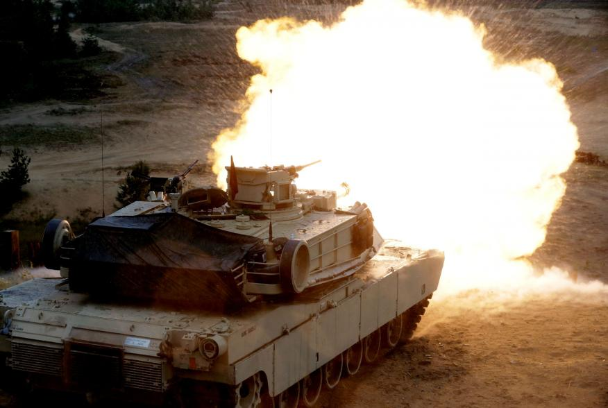 """A U.S. M1 Abrams tank fires during the """"Saber Strike"""" NATO military exercise in Adazi, Latvia, June 11, 2016. REUTERS/Ints Kalnins"""