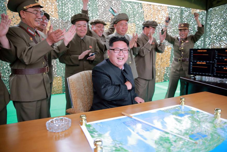 North Korean leader Kim Jong Un reacts during a test launch of ground-to-ground medium long-range ballistic rocket Hwasong-10 in this undated photo released by North Korea's Korean Central News Agency (KCNA) on June 23, 2016. REUTERS/KCNA