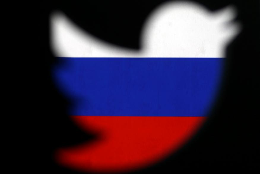 A 3D-printed Twitter logo displayed in front of Russian flag is seen in this illustration picture, October 27, 2017. REUTERS/Dado Ruvic/Illustration