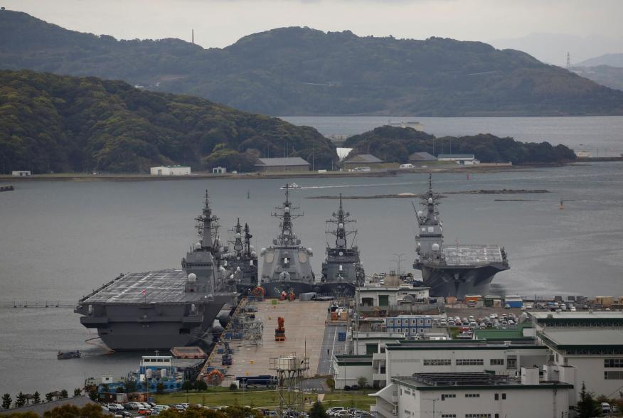 Japan Maritime Self-Defense Force's (JMSDF) latest Izumo-class helicopter carrier DDH-184 Kaga (L) and other JMSDF destroyers DD-157 Sawagari, DDG-176 Chokai, DD-104 Kirisame and DDH-182 Ise are moored at a naval base in Sasebo, on the southwest island of