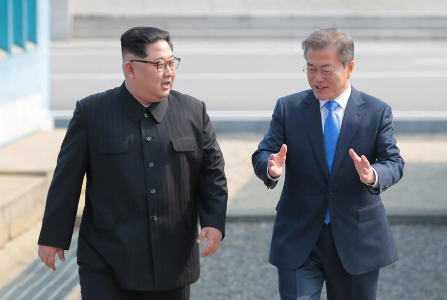 South Korean President Moon Jae-in walks with North Korean leader Kim Jong Un during their meeting at the truce village of Panmunjom inside the demilitarized zone separating the two Koreas, South Korea, April 27, 2018. Korea Summit Press Pool/Pool via Reu