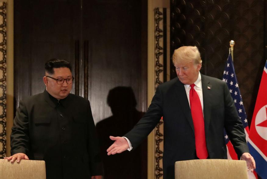 U.S. President Donald Trump and North Korea's leader Kim Jong Un arrive to sign a document to acknowledge the progress of the talks and pledge to keep momentum going, after their summit at the Capella Hotel on Sentosa island in Singapore June 12, 2018. RE