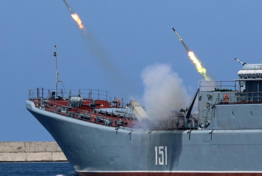 A Russian warship fires missiles during the Navy Day parade in the Black Sea port of Sevastopol, Crimea, July 29, 2018. REUTERS/Pavel Rebrov