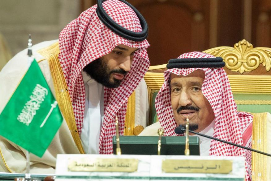 FILE PHOTO: Saudi Arabia's Crown Prince Mohammed bin Salman talks with Saudi Arabia's King Salman bin Abdulaziz Al Saud during the Gulf Cooperation Council's (GCC) Summit in Riyadh, Saudi Arabia Dec. 9, 2018. Bandar Algaloud/Courtesy of Saudi Royal Court/