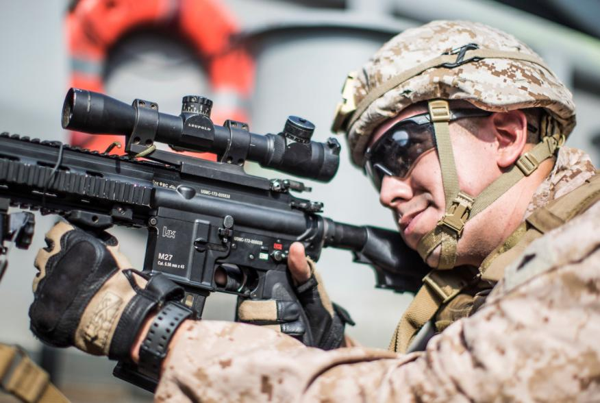 A U.S. Marine Corps rifleman with Kilo Company, Battalion Landing Team 3/5, provides security with an M27 Infantry Automatic Rifle on aboard the amphibious assault ship USS Boxer (LHD 4) during its transit through Strait of Hormuz in Gulf of Oman