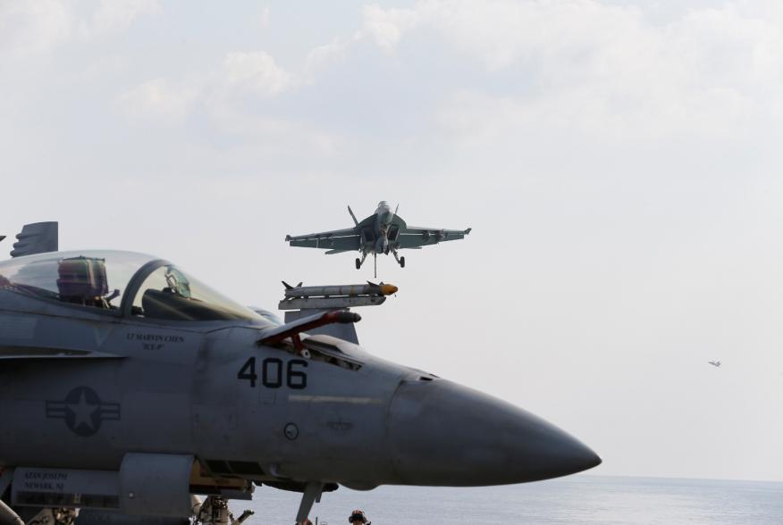 An F/A-18E Super Hornet is seen making its way to runway for landing on the flight deck of the aircraft carrier USS Abraham Lincoln (CVN 72) in the Gulf, November 23, 2019. REUTERS/ Hamad I Mohammed