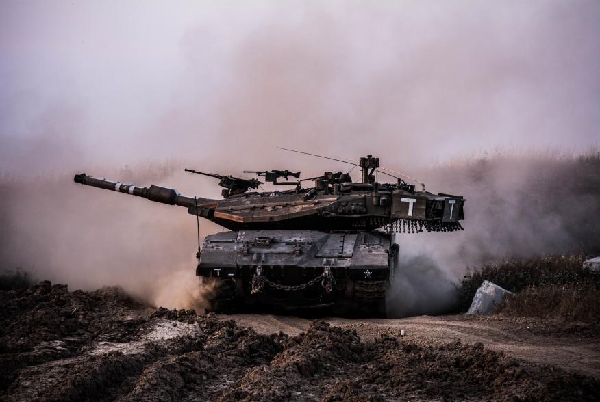 Battalion 74 tanks roll across beautiful Israeli landscapes.