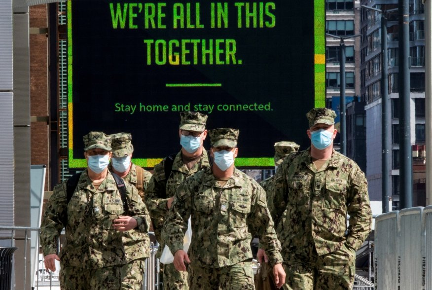 U.S. military personnel wearing face masks arrive at the Jacob K. Javits Convention Center, as the outbreak of the coronavirus disease (COVID-19) continues, in the Manhattan borough of New York City, New York, U.S., April 7, 2020. REUTERS/Eduardo Munoz TP
