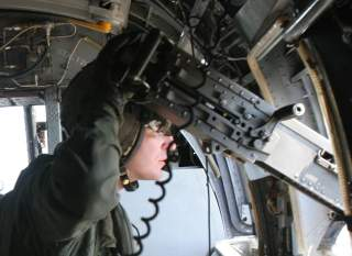 A CH-46E Sea Knight crew chief with Marine Medium Helicopter Squadron 261 mans an XM-214 .50 caliber machine gun while airborne during a helicopter-borne training exercise, aboard Camp Lejeune, N.C., March 6, 2007.