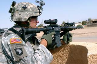 During a routine dismounted patrol to deliver school supplies, Soldiers from 1/327th Infantry Regiment, 1st Brigade Combat Team, 101st Airborne Division along with Iraqi policemen come under fire from insurgents