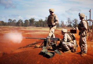 Machine gunners 1st Battalion, 3rd Marine Regiment, fire the .50 caliber M2 Browning machine gun during crew-served weapons training at Schofield Barracks, Hawaii, Oct. 8 through 10, 2013. Flickr / Marines