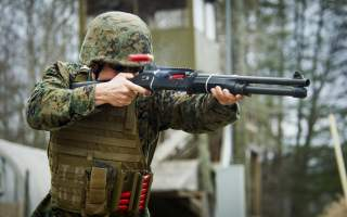 Sgt. John Browning with the United States Marine Corps Combat Shooting Team, engages a target during a live-fire range at Camp Upshur, Marine Corps Base Quantico, Va., March 12, 2014. The Marines conducted the live-fire range in order to demonstrate prope