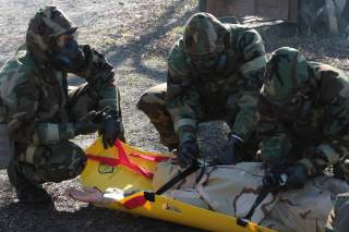 Marines from Marine Forces Reserve rescue and extract a victim from a contaminated area during a chemical, biological, radiological and nuclear defense training simulation aboard Naval Air Station Joint Reserve Base New Orleans, Feb. 5, 2015.