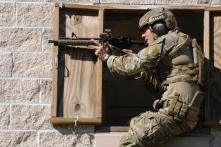 A Green Beret soldier fires a rifle during a stress shoot competition on Eglin Air Force Base, Fla., Oct. 15, 2015. U.S. Army photo by Staff Sgt. William Waller.