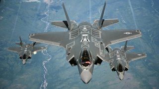 F-35A Lightning II aircraft receive fuel from a KC-10 Extender from Travis Air Force Base, Calif., July 13, 2015, during a flight from England to the U.S.
