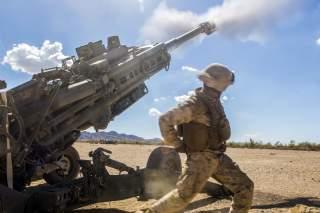 Marine Corps Cpl. Eduardo Osorionunez fires an M777 howitzer during a battle drill at Fire Base Burt, Calif., Oct. 1, 2016.