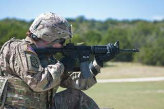 Fort Hood - 1st Lt. Elizabeth Kraft, an Army Reserve Soldier with the 316th Sustainment Command (Expeditionary), based out of Coraopolis, Pa., shoots her M4 carbine at popup targets during qualification at Fort Hood, Tx., Oct. 9, 2016.