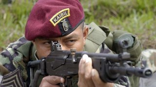 A Kaibil shows the proper way to fire a Galil assault rifle during an exhibition in the Special Forces Brigade, known as