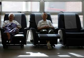 Patients Chung Kong Tuck (L), 72, and Wong Hong Jee, 85, rest at the HCA Day Care Centre in Singapore September 19, 2007. Every week, around 50 elderly terminally ill patients spend the day at the centre, where they participate in rehabilitative and socia